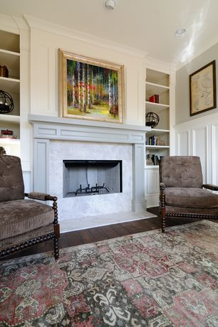 Traditional Living Room with Wainscotting, Built-in bookshelf, Crown molding, stone fireplace, Hardwood floors
