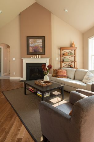 Traditional Living Room with Standard height, can lights, Fireplace, metal fireplace, Hardwood floors, Ikea Lack Coffee Table