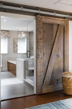 Rustic Master Bathroom with Paint 2, Rustic alder barn door, Step in shower, Exposed beam, Trista Seagrass Round Hamper