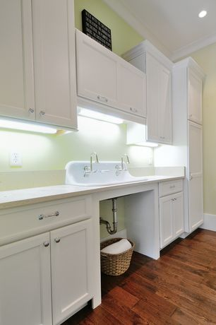 Traditional Laundry Room with Crown molding, Built-in bookshelf, can lights, Standard height, Drop-in sink, laundry sink