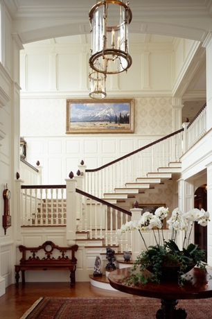 Traditional Staircase with interior wallpaper, High ceiling, Chandelier, Columns, curved staircase, Wainscotting, Loft