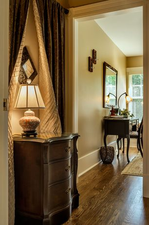 Traditional Hallway with double-hung window, Standard height, Hardwood floors, Wall sconce