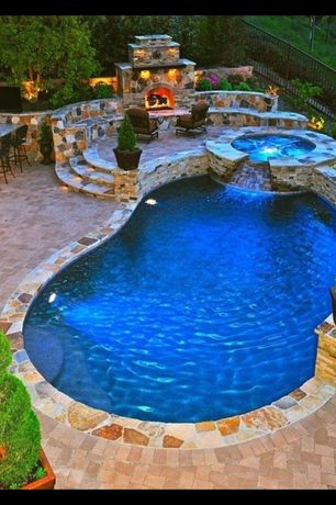 Traditional Swimming Pool with Pool with hot tub, Fence, exterior stone floors, Outdoor seating area, Outdoor fireplace