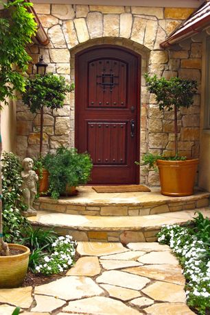 Mediterranean Front Door with Casement, Pathway, Glass panel door, exterior stone floors