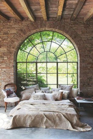 Eclectic Master Bedroom with Window seat, Arched window, Concrete, interior brick, Exposed beam, Concrete floors