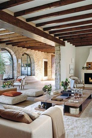 Mediterranean Great Room with French doors, Carpet, Hardwood floors, Standard height, Fireplace, Arched window, Wall sconce