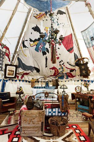 Eclectic Guest Bedroom with High ceiling, Exposed beam, Chandelier, Hardwood floors