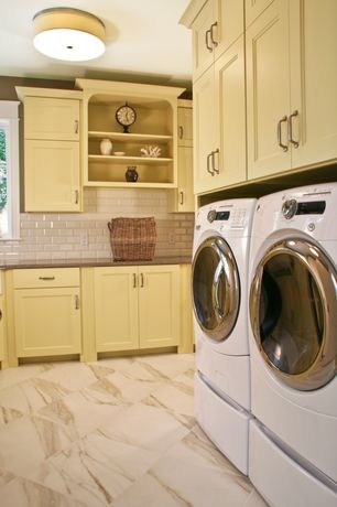 Traditional Laundry Room with Casement, Standard height, stone tile floors, sandstone tile floors, laundry sink, flush light