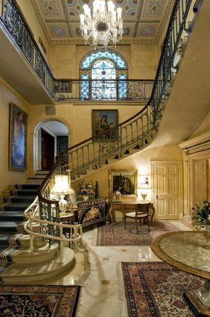 Traditional Staircase with Concrete floors, Chandelier, Balcony, Cathedral ceiling, Crown molding, Box ceiling