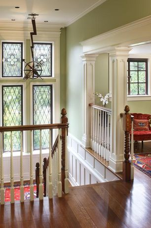 Staircase with picture window, Wainscotting, can lights, Crown molding, Columns, Standard height, curved staircase, Casement