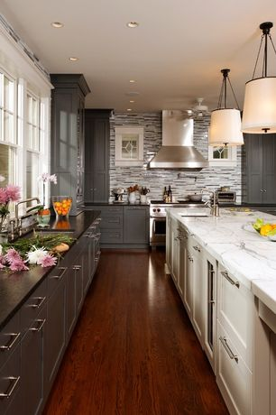 Traditional Kitchen with Undermount sink, Ceramic Tile, L-shaped, Slate counters, Barrel shade pendant dove, Glass panel