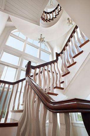 Cottage Staircase with Pendant light, Crown molding, Hardwood floors, High ceiling, Arched window
