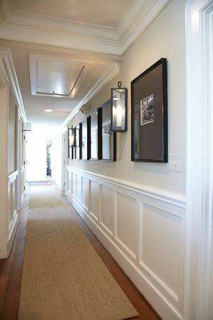 Traditional Hallway with Wall sconce, six panel door, Chair rail, Paint 2, Wainscotting, Exposed beam, Paint 1, can lights