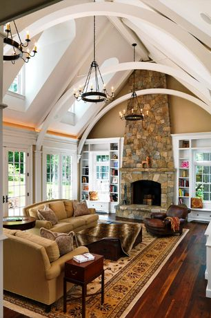 Craftsman Living Room with Window seat, Eldorado stone country rubble, stone fireplace, Exposed beam, Hardwood floors