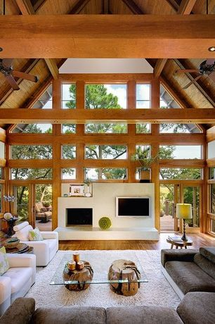 Contemporary Living Room with stone fireplace, Ceiling fan, Log Coffee Table #1, High ceiling, Exposed beam, Hardwood floors