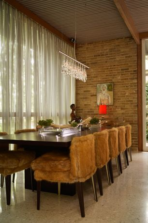 Contemporary Dining Room with Chandelier, sandstone floors, Exposed beam