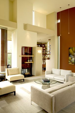 Contemporary Living Room with Martin Table Lamp, Carpet, Warren platner coffee table, High ceiling, Built-in bookshelf
