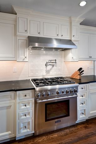 Traditional Kitchen with can lights, Framed Partial Panel, full backsplash, Standard height, Wall Hood, gas range, One-wall