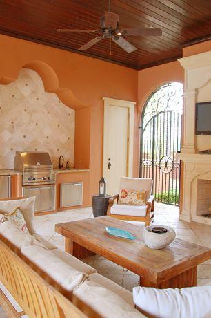 Mediterranean Porch with Outdoor kitchen, six panel door, Paint, Gate, Ann sacks limestone tile, exterior tile floors, Tile