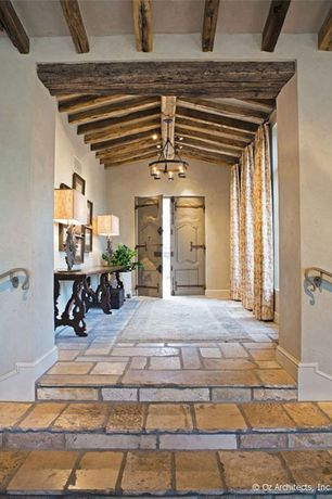 Mediterranean Entryway with stone tile floors, flush light, Chandelier, Paint, Exposed beam, Standard height