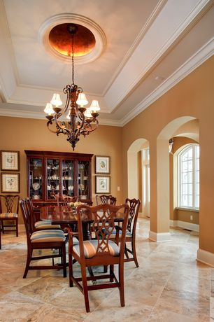 Traditional Dining Room with Columns, stone tile floors, complex marble tile floors, Crown molding, Built-in bookshelf