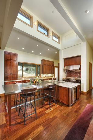 Contemporary Kitchen with Stainless steel counters, Cathedral ceiling, U-shaped, Complex Granite, Flush, Wall sconce