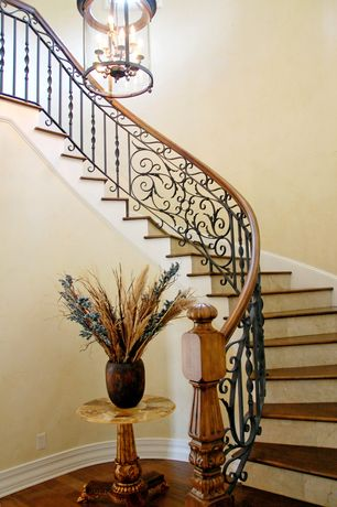 Mediterranean Staircase with Hardwood floors, High ceiling, Chandelier