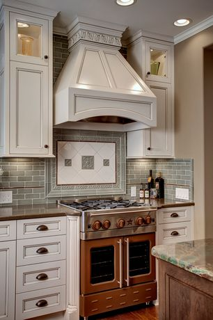 Traditional Kitchen with Soapstone counters, full backsplash, Onyx counters, One-wall, Standard height, Custom hood, Flush
