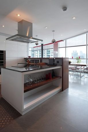 Contemporary Kitchen with Kitchen peninsula, Pendant light, Cad lounge chair in black, U-shaped, Soapstone counters