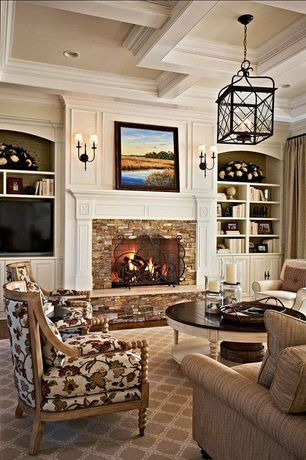 Traditional Living Room with Old hickory tannery ellesworth spindleback chair, Neutral area rug, Crown molding, Wall sconce