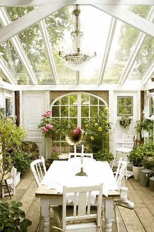 Cottage Porch with Arched window, Screened porch, Trellis, Glass panel door, Rustic dining table, Crystal chandelier, Sunroom