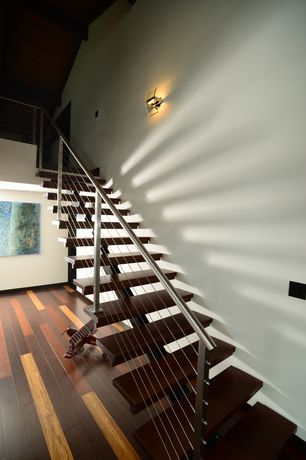 Modern Staircase with Cathedral ceiling, Wall sconce, Hardwood floors, Loft, Metal staircase
