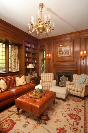 Traditional Living Room with Built-in bookshelf, Crown molding, Chandelier, Carpet, specialty window, Standard height