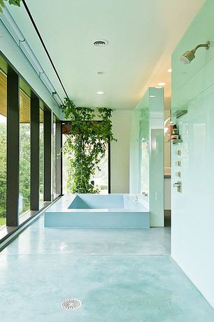 "Contemporary Master Bathroom with Poured concrete floors, Moen kingsley posi-temp shower, Surf glass 4"" x 12"" subway tile"