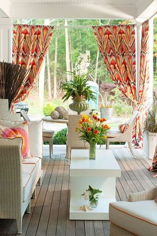Eclectic Patio with Outdoor wicker furniture, Covered patio, Outdoor curtain