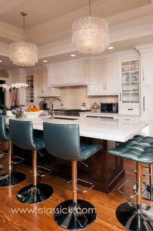 Traditional Kitchen with European Cabinets, Custom hood, Glass panel, Corian counters, Standard height, full backsplash
