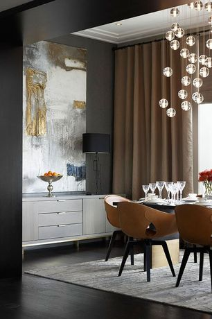 Contemporary Dining Room with Built-in bookshelf, Pendant light, Large scale artwork, Dark hardwood floors, can lights, Paint