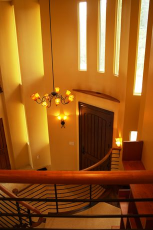 Eclectic Staircase with Cathedral ceiling, curved staircase, Hardwood floors, picture window