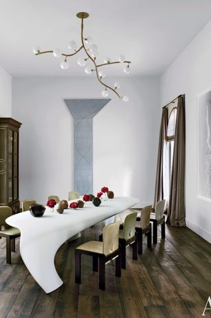 Contemporary Dining Room with Chandelier, Built-in bookshelf, Hardwood floors