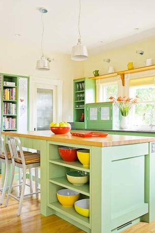 Eclectic Kitchen with Kitchen island, Undermount sink, flush light, Breakfast bar, Glass panel, Wood counters, Pendant light