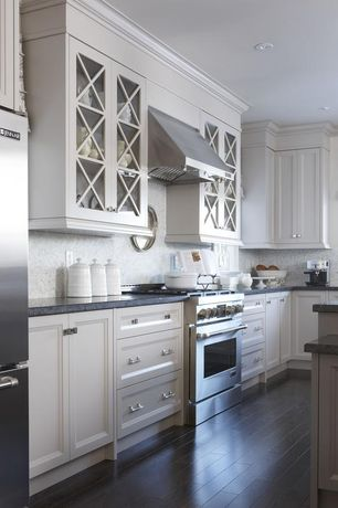 Traditional Kitchen with Soapstone counters, Glass panel, full backsplash, L-shaped, Multiple Refrigerators, can lights