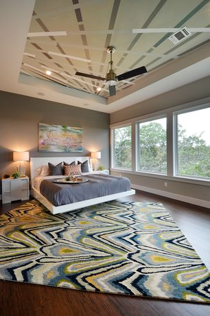 Contemporary Master Bedroom with Ceiling fan, Hardwood floors