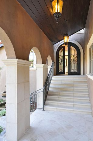 Traditional Front Door with French doors, Deck Railing, exterior stone floors, Pathway