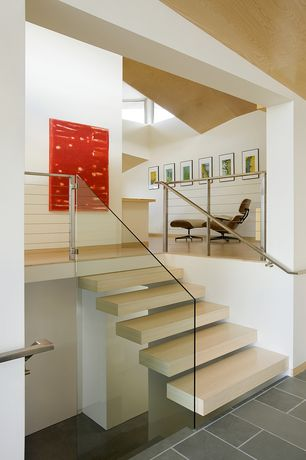 Contemporary Staircase with Laminate floors, Floating staircase