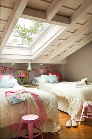 Eclectic Kids Bedroom with Skylight, Hardwood floors, Pink and navy bunting, Pb metal stool pink, Star pillow cloud blue