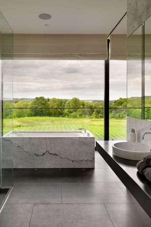 Contemporary Master Bathroom with drop in bathtub, slate tile floors, Marble tub surround, Shower, Curtain wall, can lights