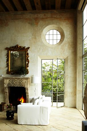 Rustic Living Room with Exposed beam, Ancient Surfaces Antique fireplace, sanded frescoed walls, French doors, High ceiling