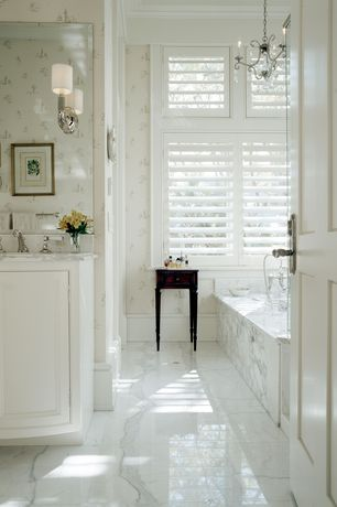 Traditional Master Bathroom with Chandelier, Complex Marble, drop in bathtub, Casement, partial backsplash, stone tile floors