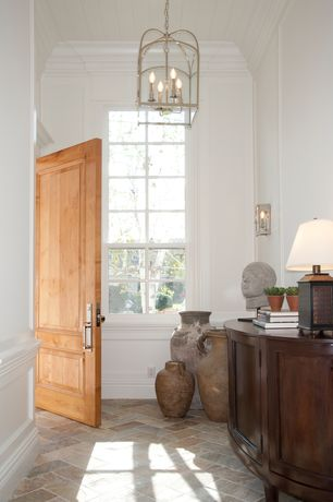 Traditional Entryway with specialty door, Crown molding, specialty window, Chandelier, Wall sconce, Wainscotting