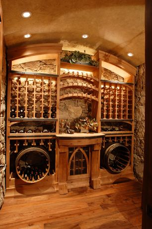 Mediterranean Wine Cellar with Hardwood floors, Designer series 60-bottle 6-column half height wine rack, High ceiling